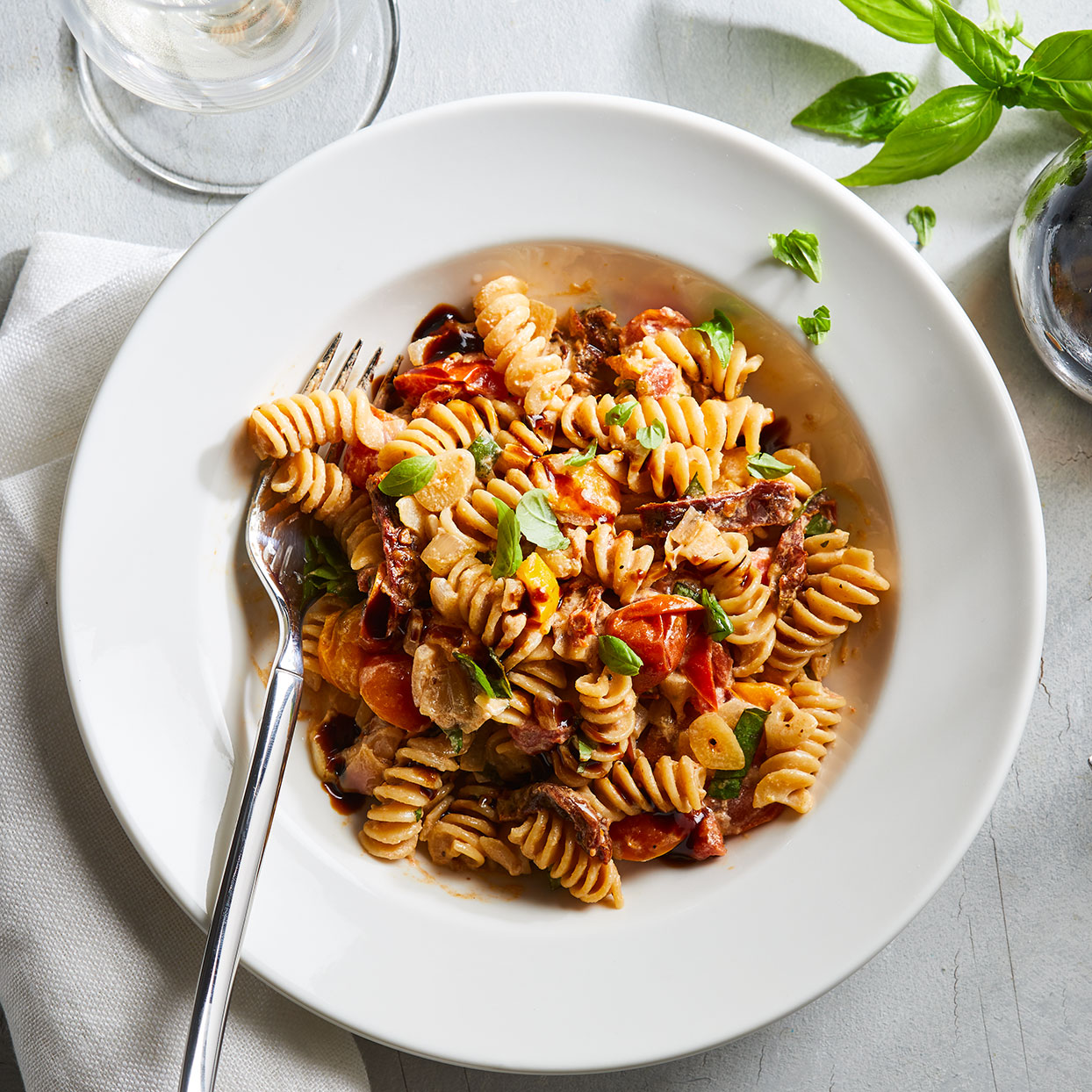 Got garden-fresh tomatoes? This simple vegetarian pasta is a great place to use them up. Both large tomatoes and cherry tomatoes work well. The addition of sun-dried tomatoes and Parmesan cheese elevates the flavor, while a drizzle of sweet balsamic glaze at the end adds a sweet note.