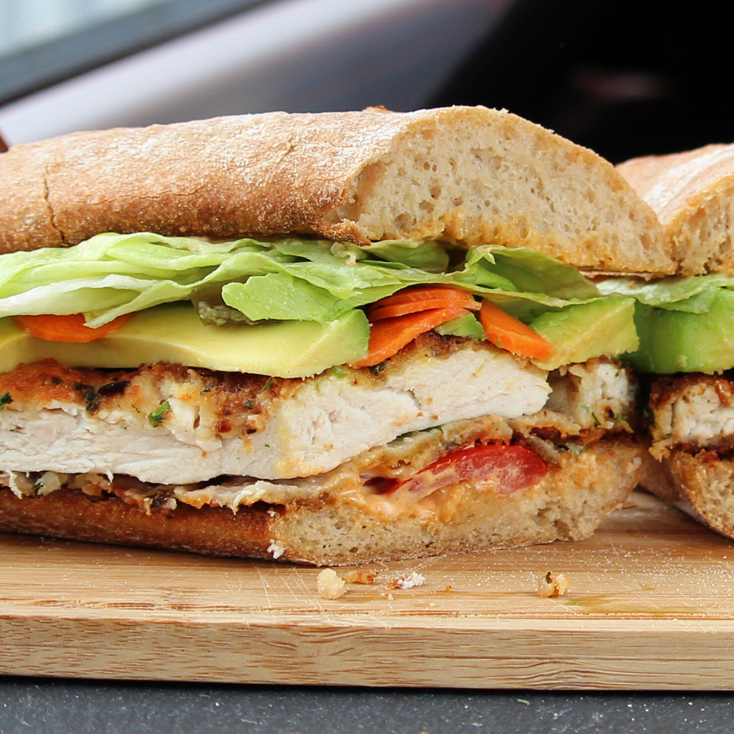 In this mouthwatering Mexican-style fried chicken sandwich, strips of crispy breaded chicken are served in warm rolls with spicy mayo, avocado, tomato, lettuce, pickled carrots, and jalapenos. Serve with the remaining spicy mayonnaise for dipping.