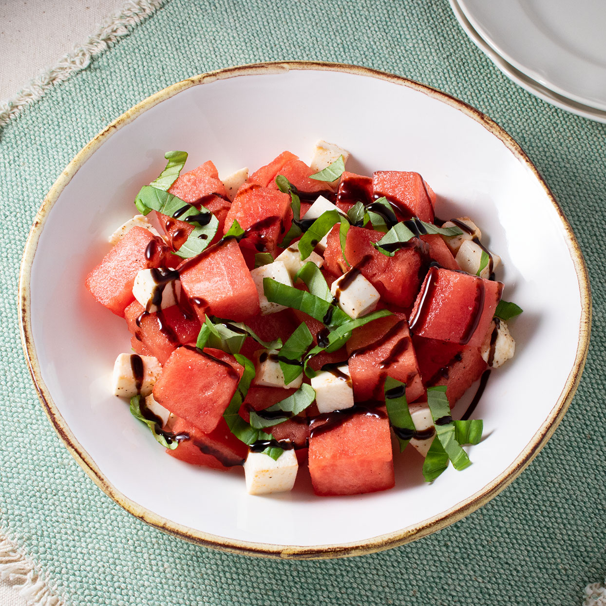 This refreshing twist on the classic caprese salad replaces tomatoes with sweet, juicy watermelon. Basil and balsamic vinegar push this easy summer salad to the savory side, but if you want some sweeter notes, opt for balsamic glaze. An optional drizzle with extra-virgin olive oil at the end helps marry the flavors. Source: EatingWell.com, July 2020