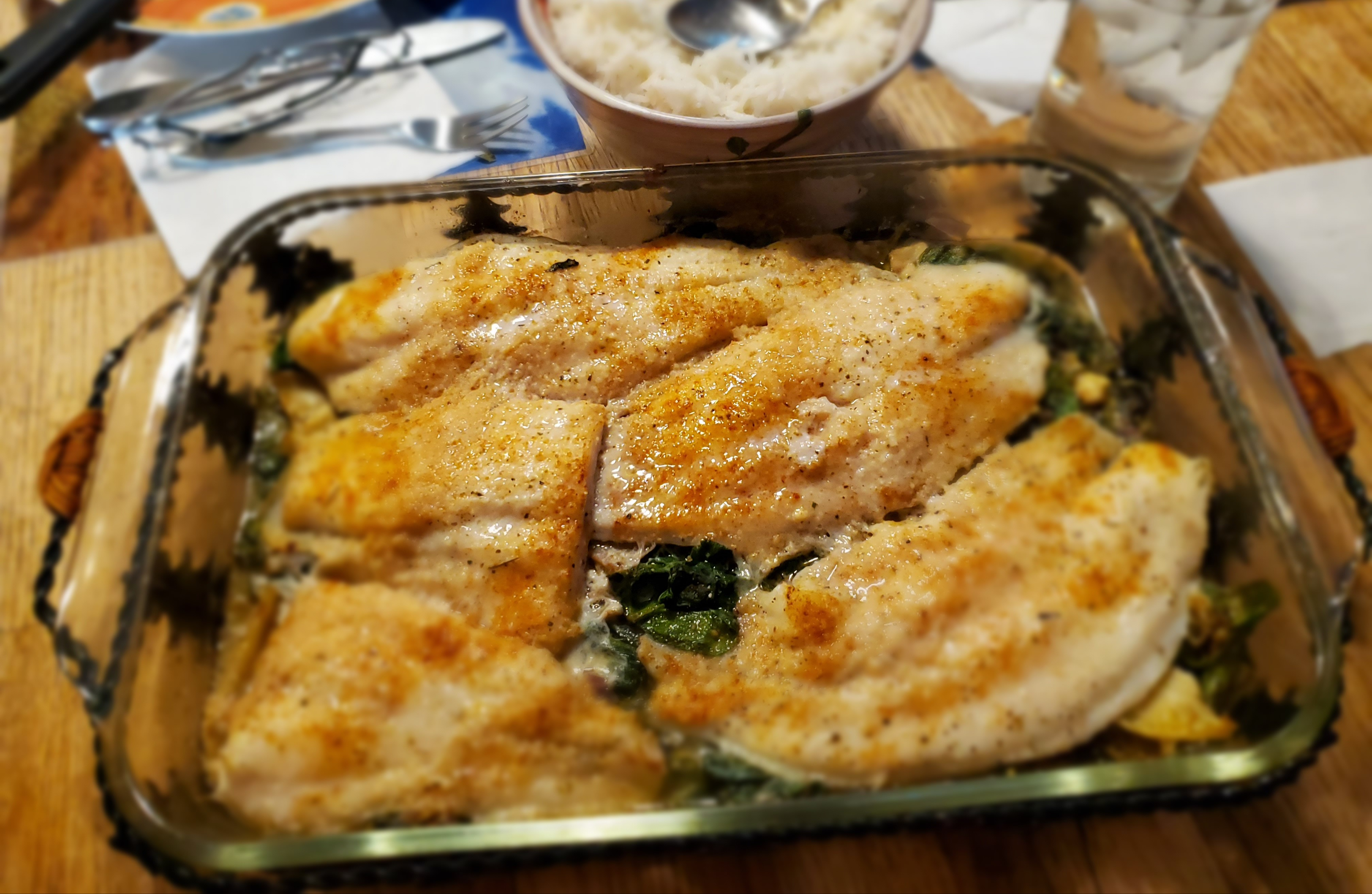"""Plenty of Mediterranean flavors in this tilapia dinner: olive oil, lemon, garlic, and feta cheese. It's served Florentine-style with fresh spinach. """"A very clean, fresh, and satisfying Mediterranean dish,"""" says Eddie Riddell."""