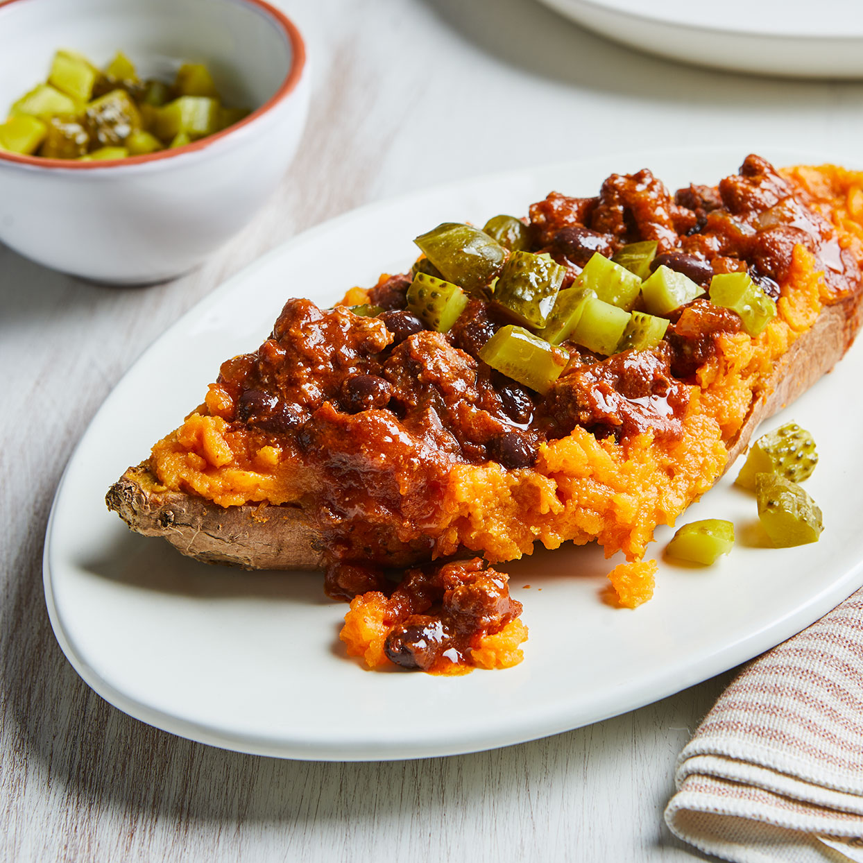 Take sloppy Joes to a new level with tender sweet potatoes standing in for the bun. Sweet potatoes pair perfectly with the tangy, flavorful filling of ground beef, black beans and spices. Chopped dill pickle sprinkled on top adds crunch to this quick weeknight dinner the whole family will love.