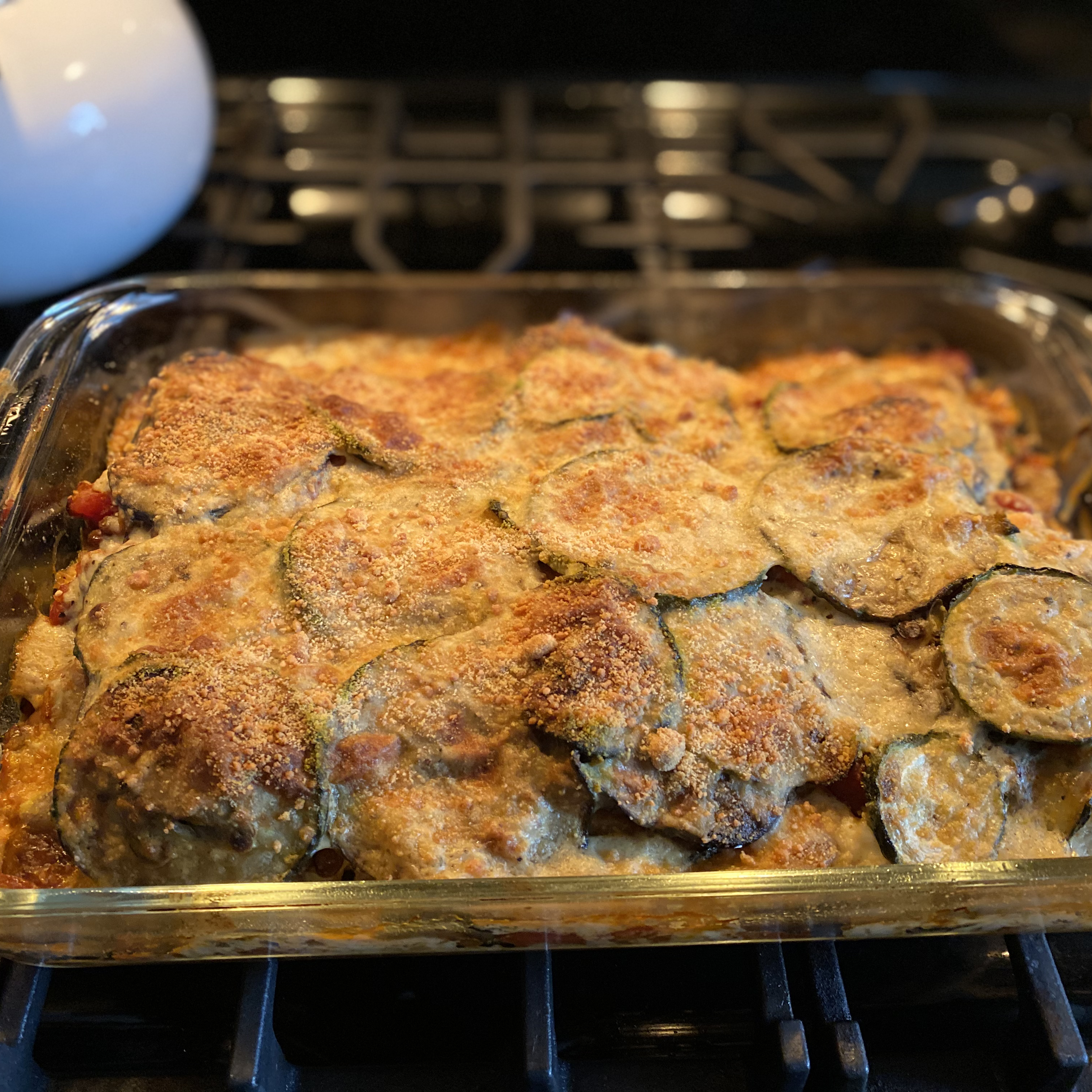 "Slices of eggplant, zucchini, potatoes and onion are layered with tomatoes and lentils and baked with a bechamel white sauce. ""Spectacular!"" raves MeatballMatt. ""Very good, easy to make. Everybody loved this, and it was filling. Will make again."""