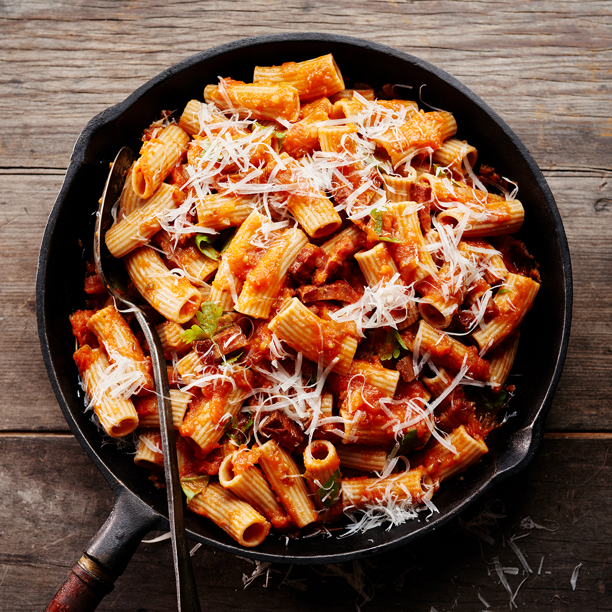 Created by chef Fabio Viviani of Siena Tavern in Chicago, this Amatriciana sauce is a classic of modern Roman cooking (though it most likely came from the town of Amatrice about 90 miles away). Typically, it's made with few ingredients: garlic, guanciale (cured pork jowl), cheese and tomato. This version doctors up jarred sauce to keep it quick and calls for easy-to-find pancetta in place of the guanciale. This tomato sauce is sometimes paired with bucatini; here, Fabio dresses up rigatoni with it.