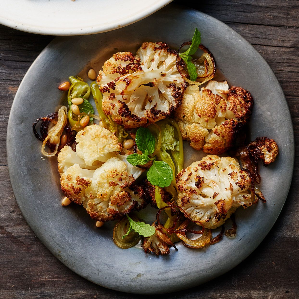 Don't be tempted to jam all the cauliflower onto one sheet pan in order to make fewer dirty dishes. Spreading it out on two pans ensures that it gets golden brown.