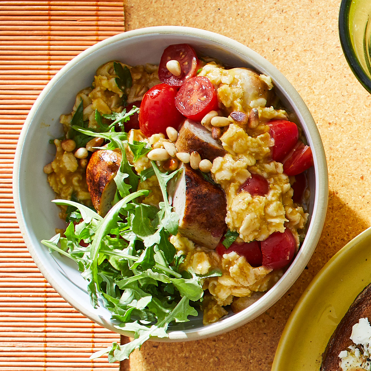 Oats get a new life in this savory dish, serving as the backbone for a satisfying combo of sausage, greens, tomatoes, and herbs.