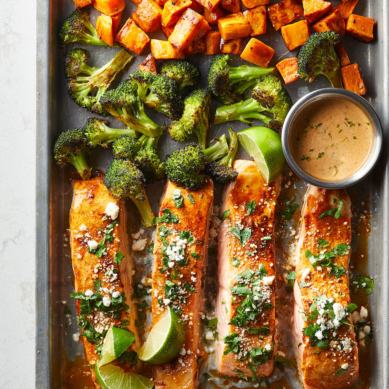 The vibrant combo of cheese, cilantro, chili, and lime--inspired by Mexican street corn--makes this salmon sheet-pan dinner burst with flavor. Source: Diabetic Living Magazine, Fall 2020