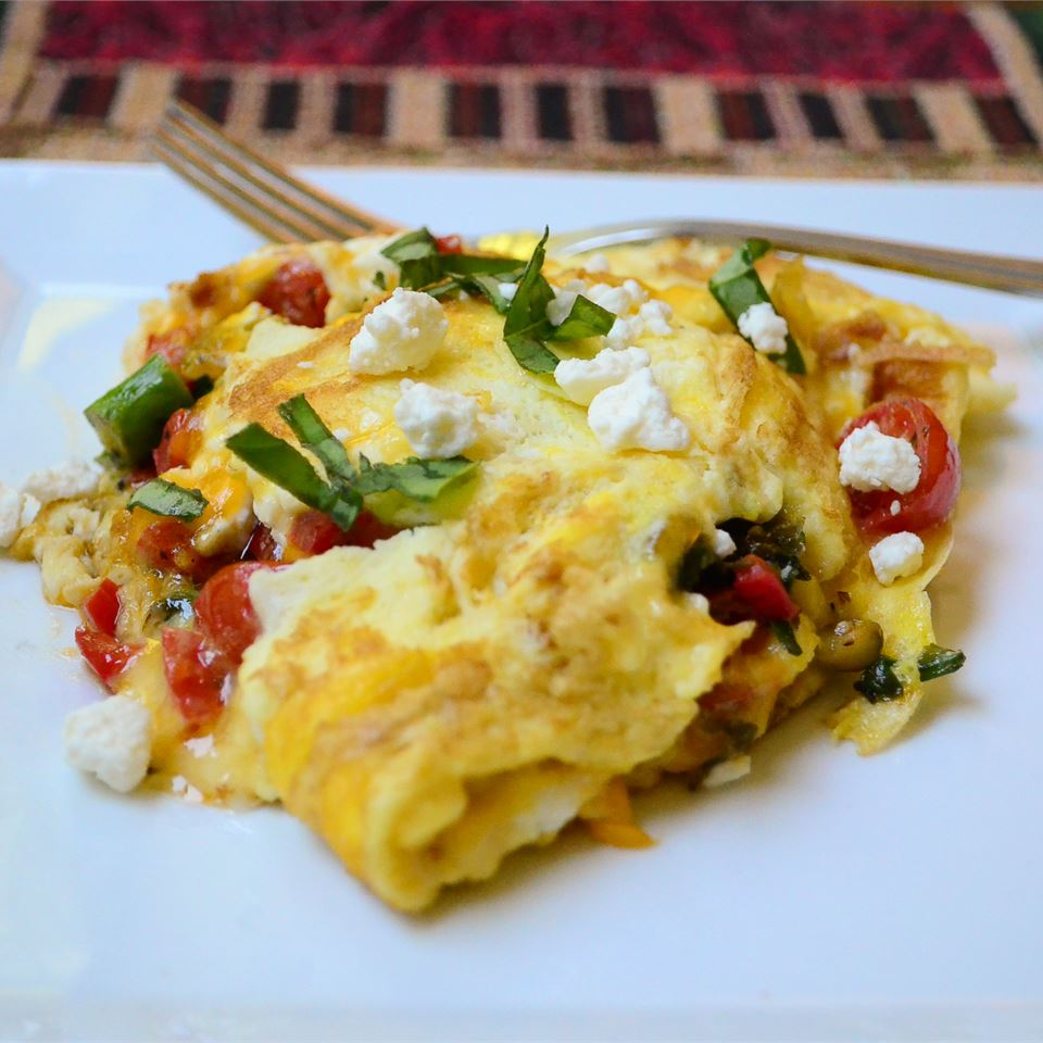 """This omelet is filled with a mixture of cherry tomatoes, spinach, bell pepper, and asparagus,"" says Valerie Brunmeier. ""Feta cheese gives it that distinctive Greek flavor that pairs perfectly with the veggies."""