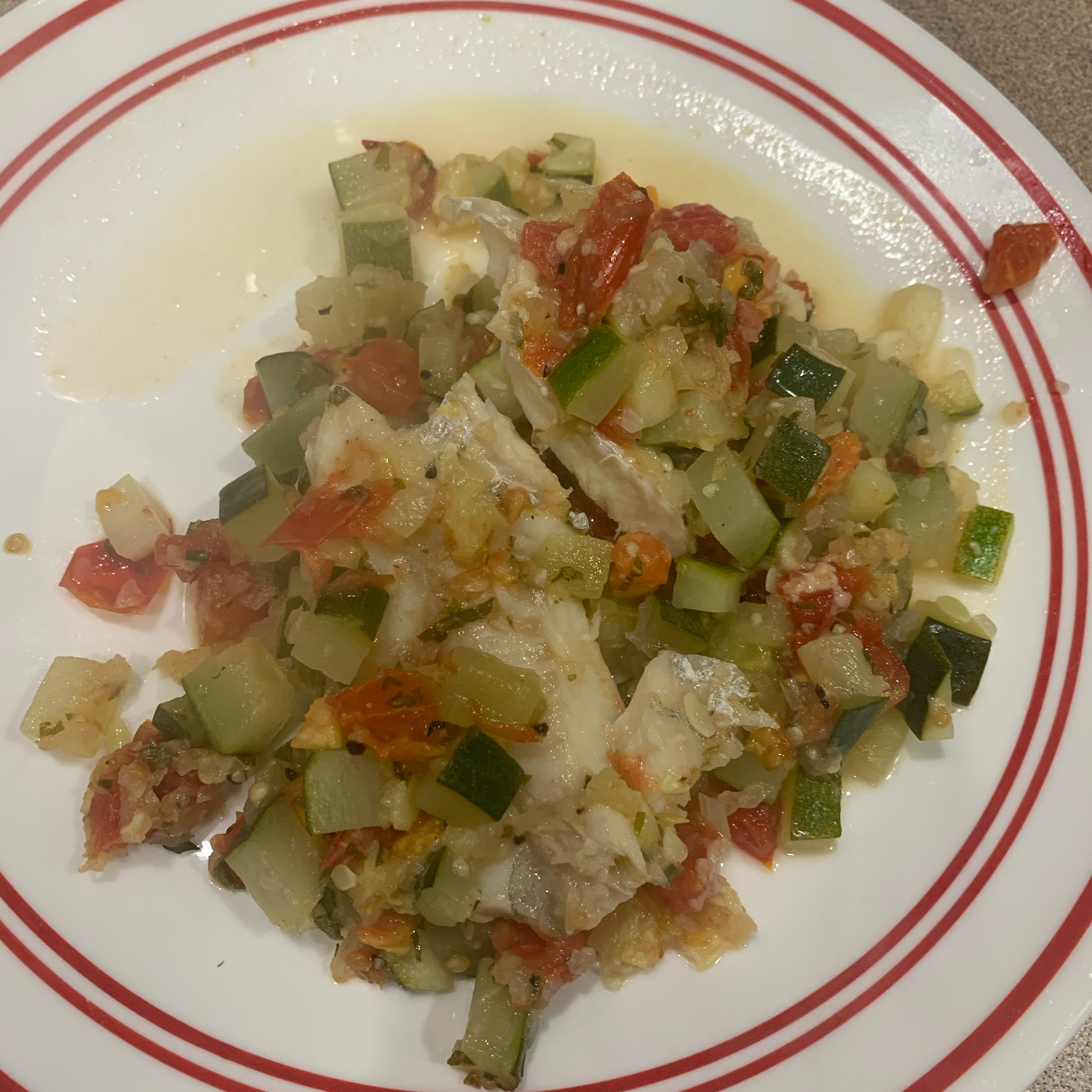 """""""An Italian-style vegetable (zucchini, tomatoes, onions, garlic) and feta cheese topping is the perfect enhancement to delicious baked halibut,"""" says dakota kelly. Jeremy recommends adding a nice pinch of crushed red pepper flakes and a splash of lemon juice at the end."""