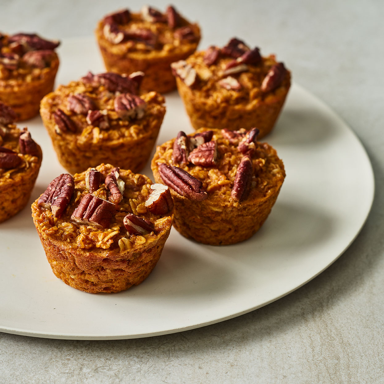 These healthy pumpkin-oatmeal muffins will get you in the mood for fall. Sprinkling the muffins with pecans adds a nutty crunch to every bite. Serve them for breakfast or as a grab-and-go snack.