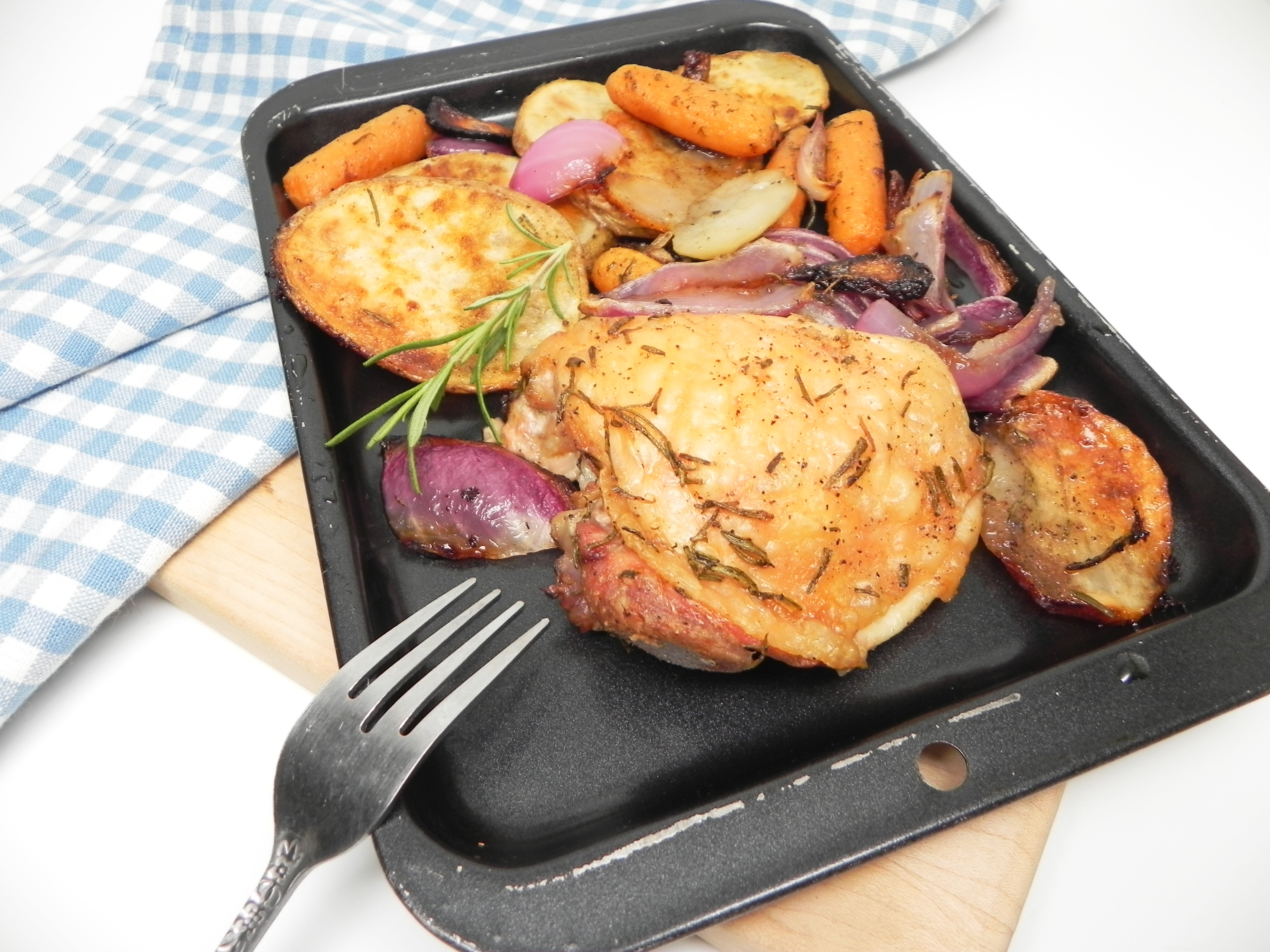 Chicken thighs roast to perfection along with carrots, turnips, potato, garlic and onion. It's a hearty and comforting sheet pan meal for two that can easily be transformed to any season by using spring, summer, or fall veggies.