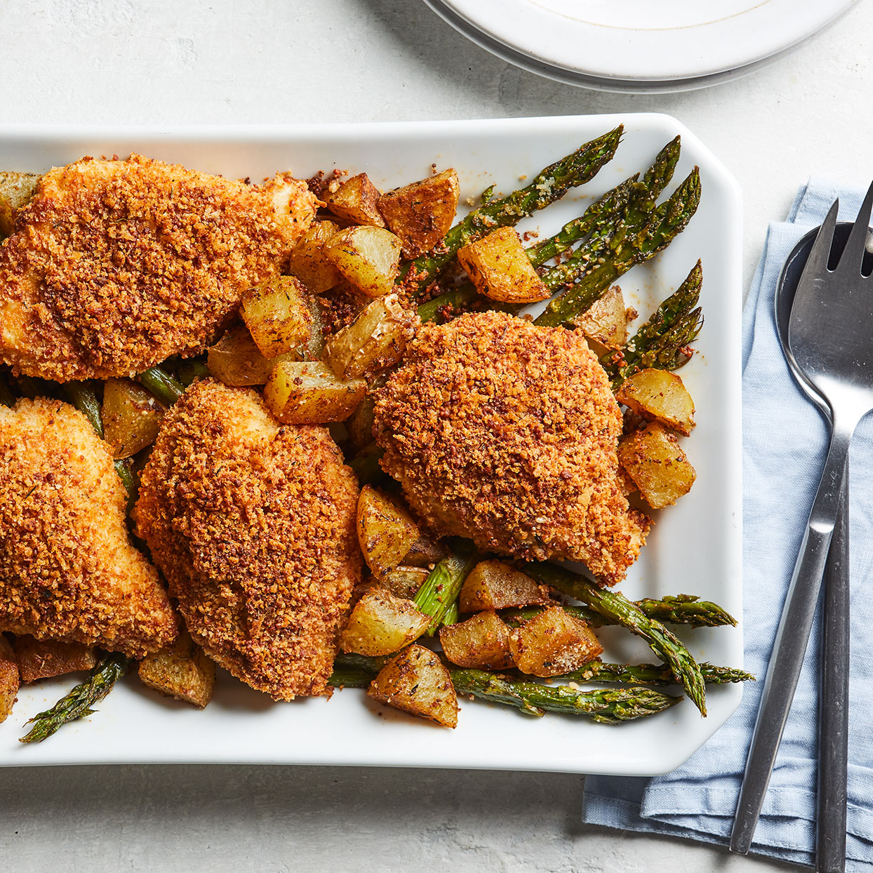 This one-pan dinner combines savory Parmesan cheese and panko-coated chicken breast with asparagus and potatoes tossed with spices to create an easy meal the whole family will love. Source: EatingWell.com, August 2020