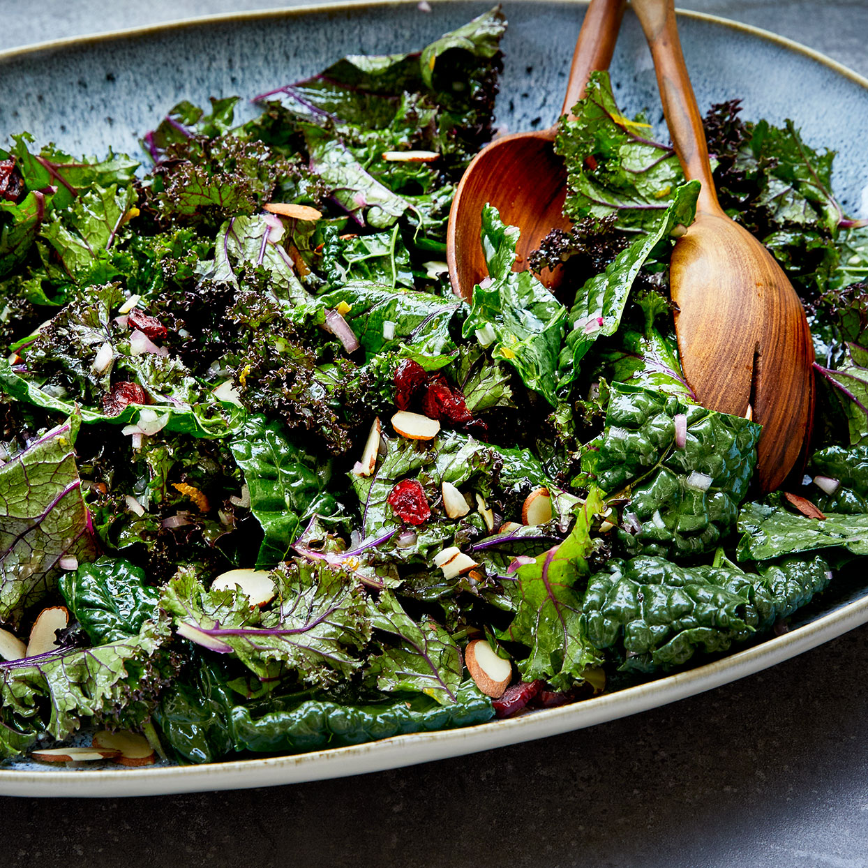 This easy holiday salad gets its flavor from a sweet citrus dressing that's infused into the kale by massaging the greens and the dressing together with your hands. We like a mix of kale for this recipe, but any type of kale will work.