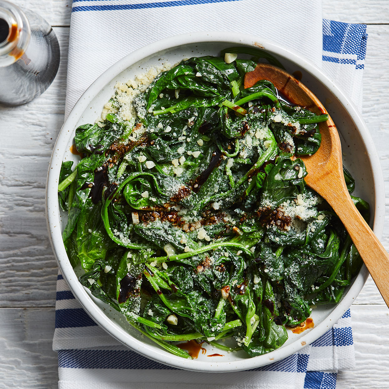 Tender spinach with a hint of garlic, Parmesan cheese and sweet balsamic vinegar makes a quick and flavorful side dish. The sturdy leaves of mature spinach hold up best during cooking.