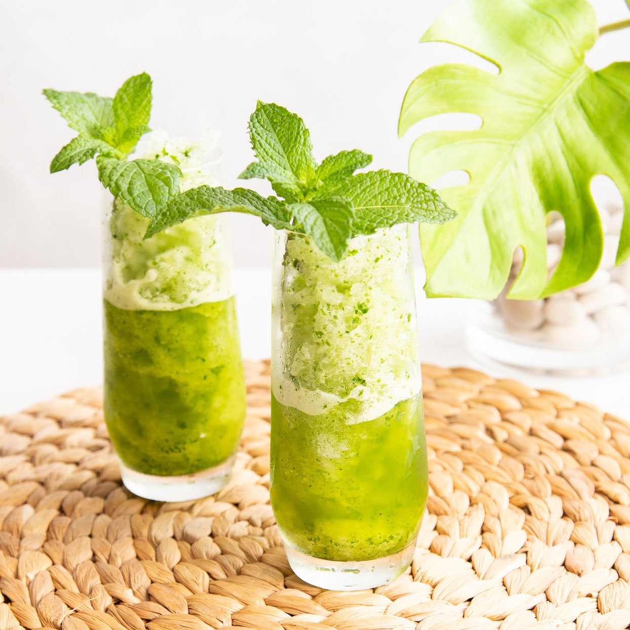This frozen blender cocktail pays homage to the classic Cuban mojito cocktail, a refreshing blend of mint, limes, sugar and rum. This easy-breezy sipper is easy to make for 2 people in minutes.