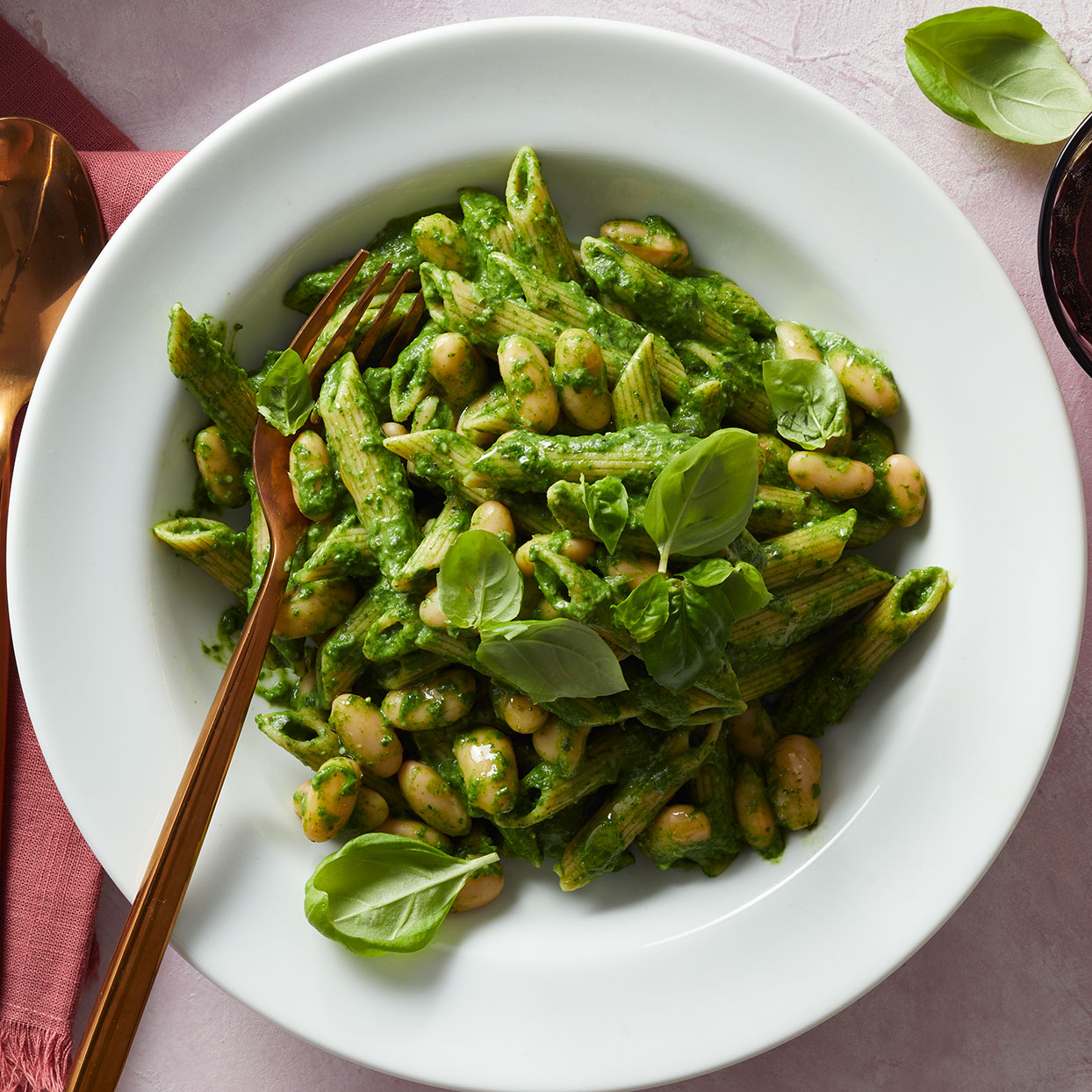 Here, we whir up fresh spinach and kale with cream cheese and Gruyère for the luscious sauce that highlights this rich pasta dish. Paired with beans, it makes a filling vegetarian meal.