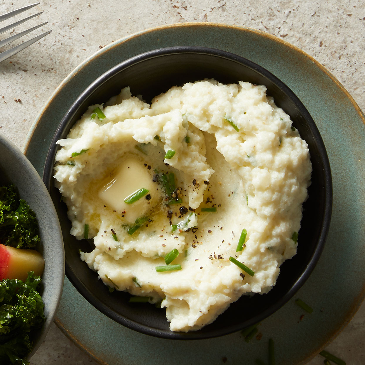 This mashed cauliflower recipe with butter and sour cream mimics the taste and texture of mashed potatoes. The swap saves you 40 grams of Carbohydrates and 100 calories per cup, plus it quadruples the vitamin C, giving you 82% of your Daily Value of the immune-boosting nutrient.