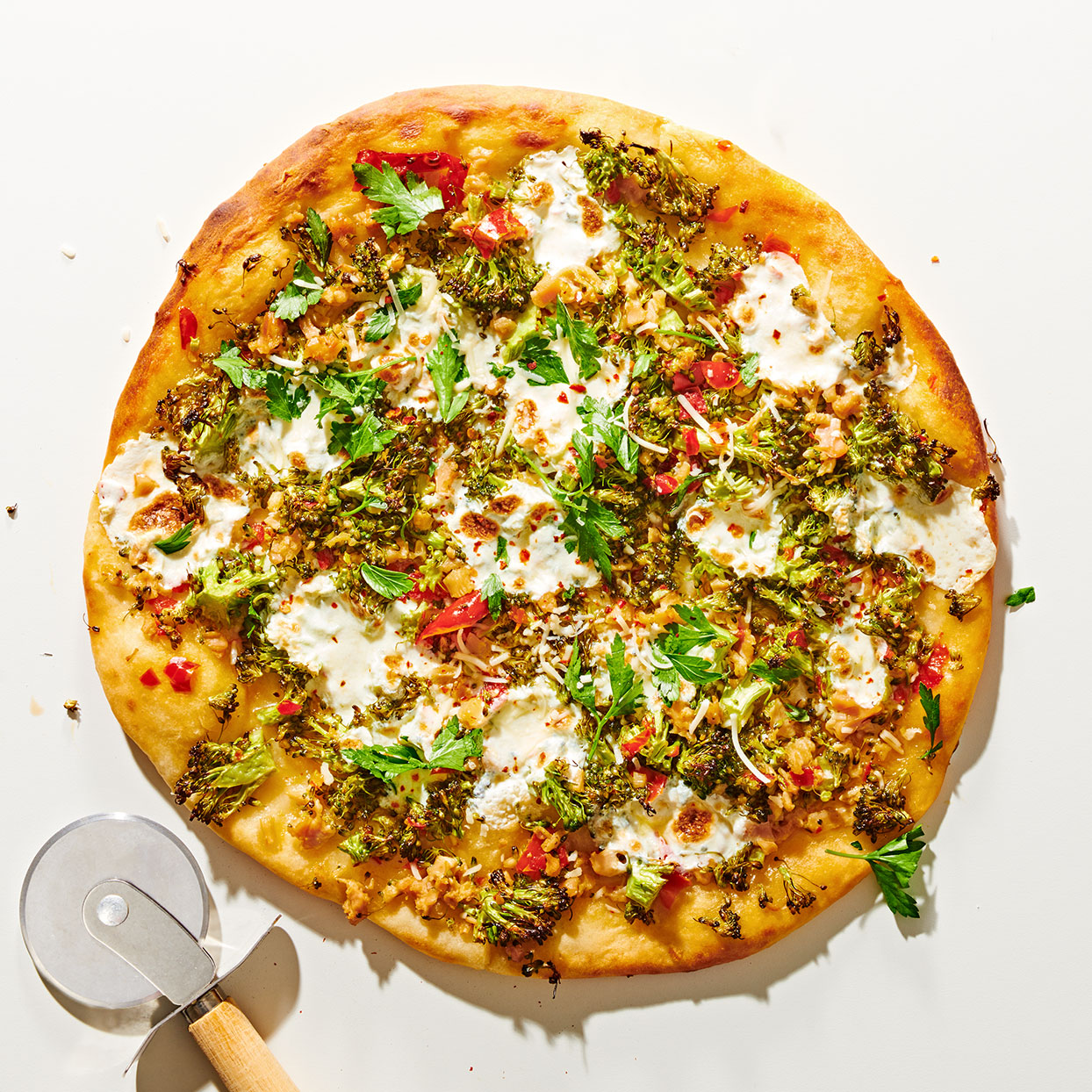 This recipe unites two East Coast favorites: white clam pizza from New Haven and the spicy fra diavolo sauce made famous in New York. Jarred Calabrian peppers heat it up and two-ingredient pizza dough makes it easy.