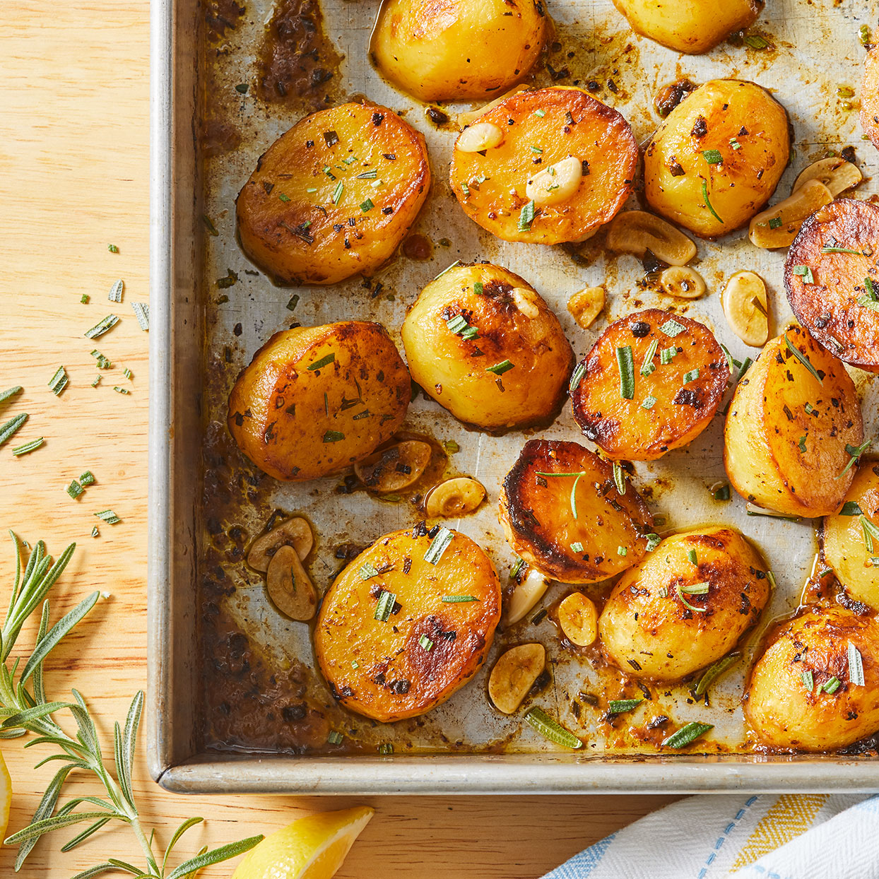 "These full-flavored potatoes are a great new approach to your typical potato side dish. The potatoes roast, then ""melt"" with the flavors of lemon, rosemary and garlic. They're good enough for a special occasion, but easy enough for a weeknight."