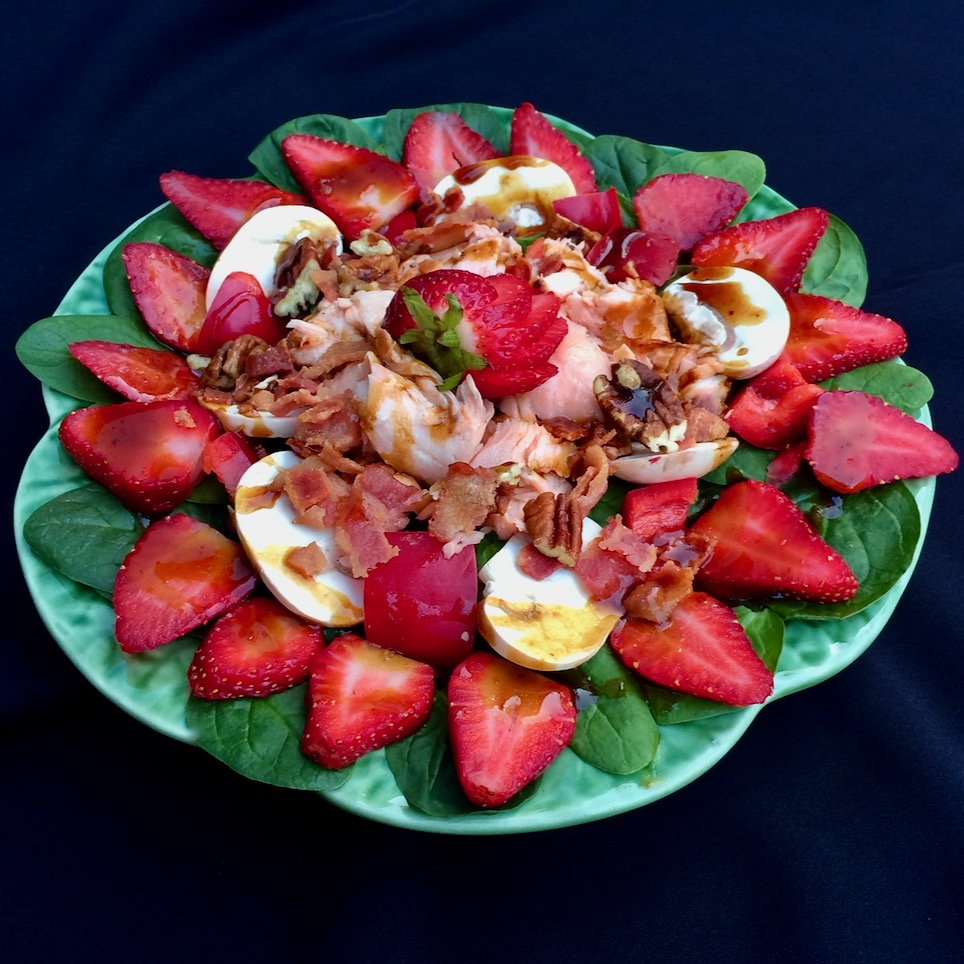 Balsamic vinaigrette and fresh strawberries play a starring role in this beautiful salmon and spinach salad, a creation from Allrecipes Allstar Bibi.