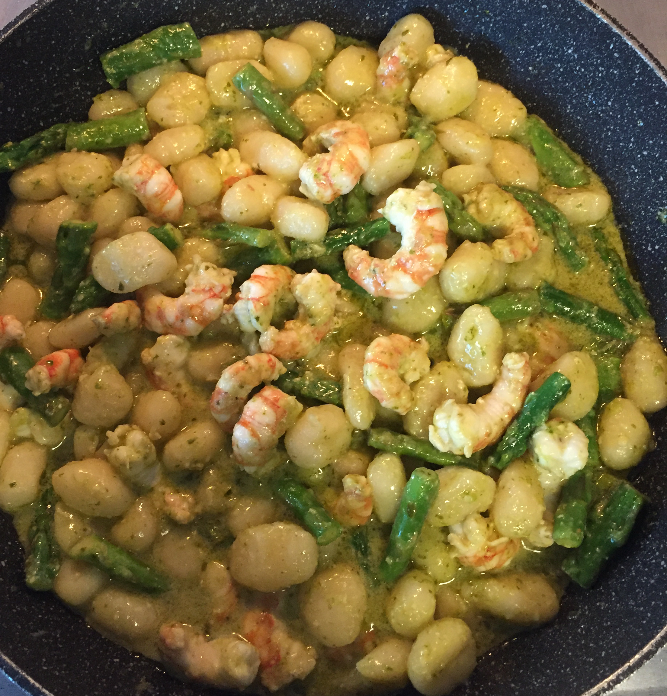 "Shrimp and asparagus are sauteed with gnocchi in pesto. ""This combination of flavors is surprisingly delicious,"" says Erica Monjeau."