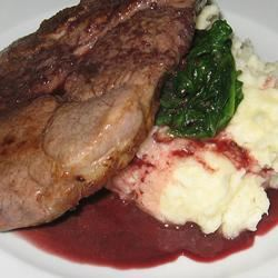 Cumin Lamb Steaks with Smashed Potatoes, Wilted Spinach and Red Wine Sauce