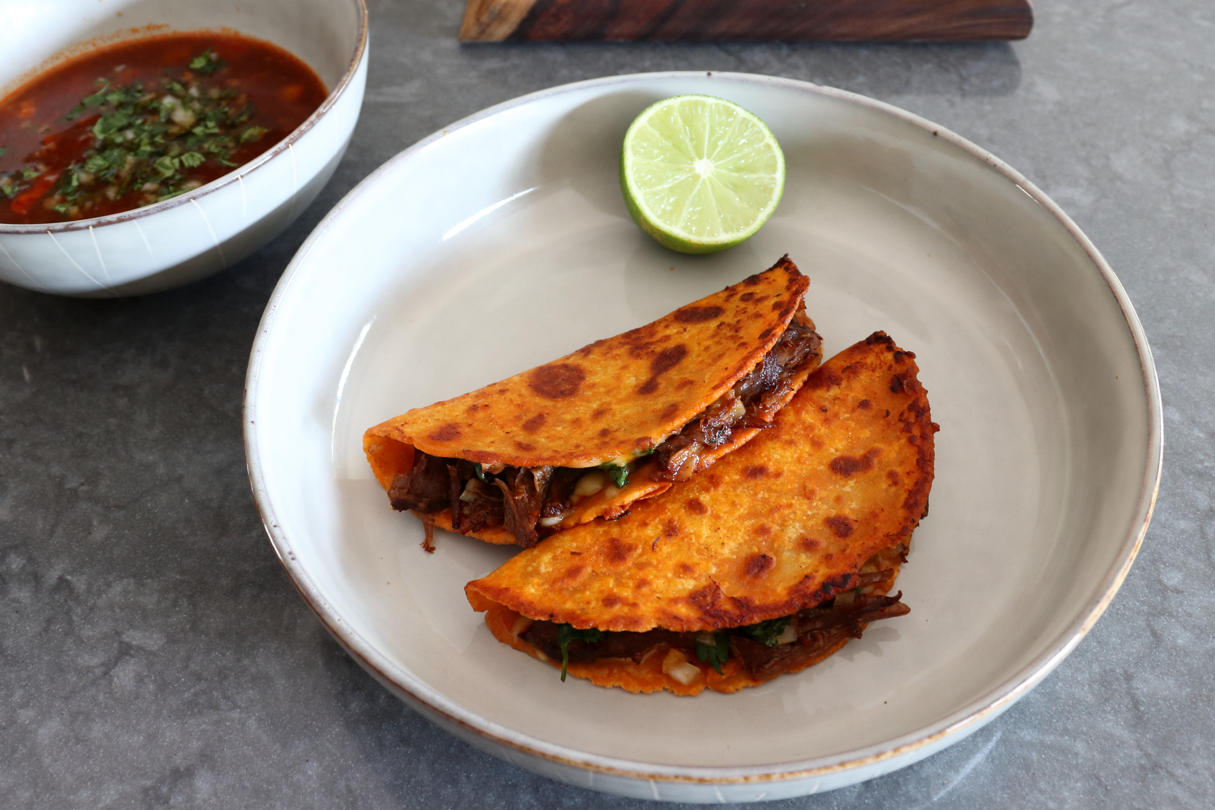 Beef Birria Queso Tacos with Consomé