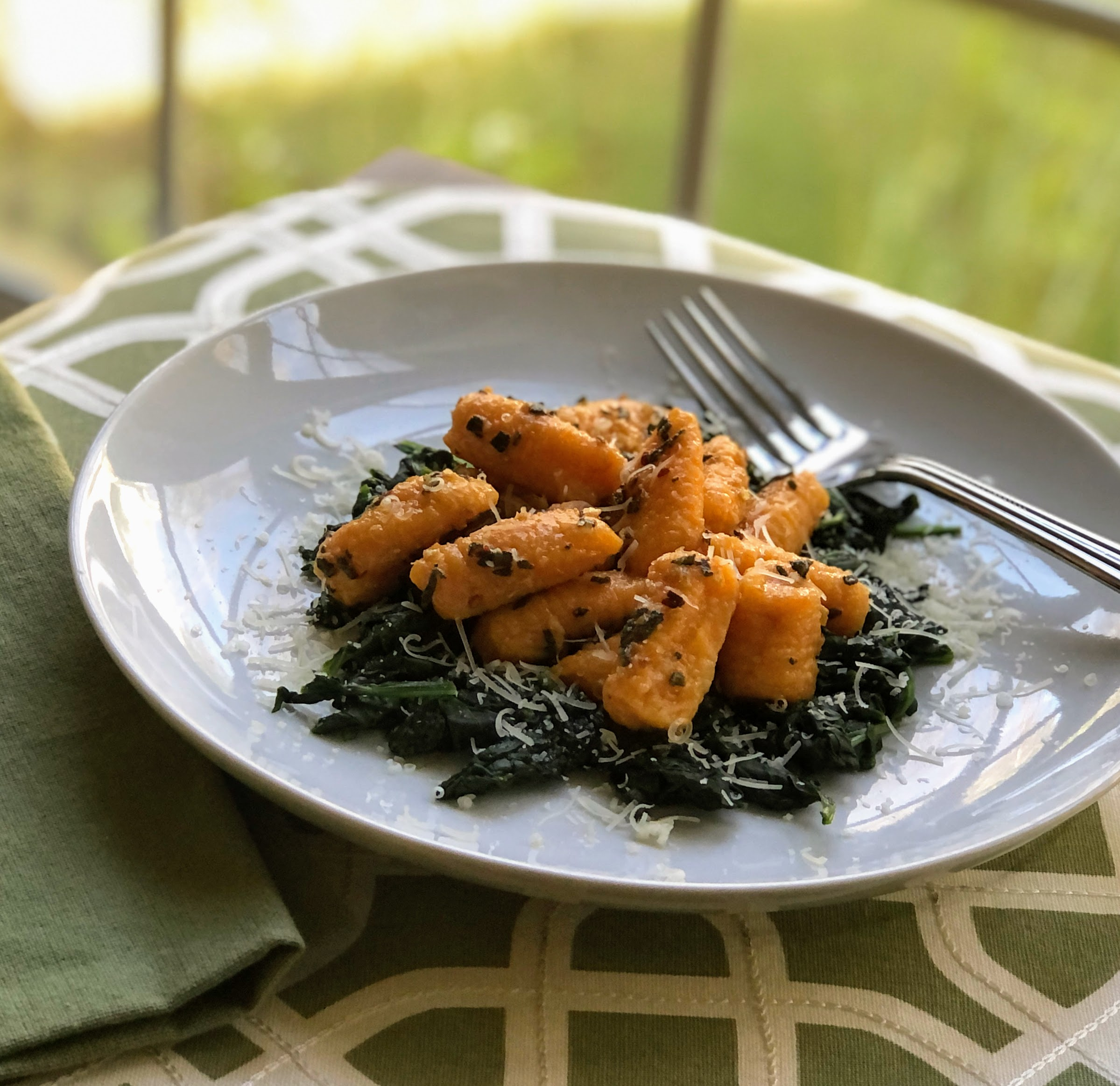 Butternut Squash Gnocchi with Garlic-Sage Butter over Wilted Spinach