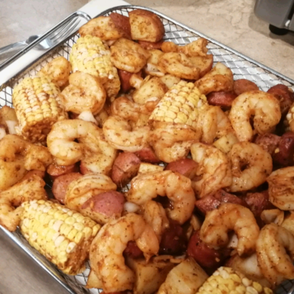 """""""All the flavors you love in a shrimp boil in a fraction of the time and with a lot less mess,"""" says Soup Loving Nicole. """"No need to wait for a pot of water to boil just to stand over it making sure it doesn't boil over. Air fryer to the rescue! While this is a less messy version, the way I chose to cut the corn still lets you dig in and get your hands messy for that authentic touch. The cob creates a perfect handle for holding while the kernels face upright for easy access."""""""