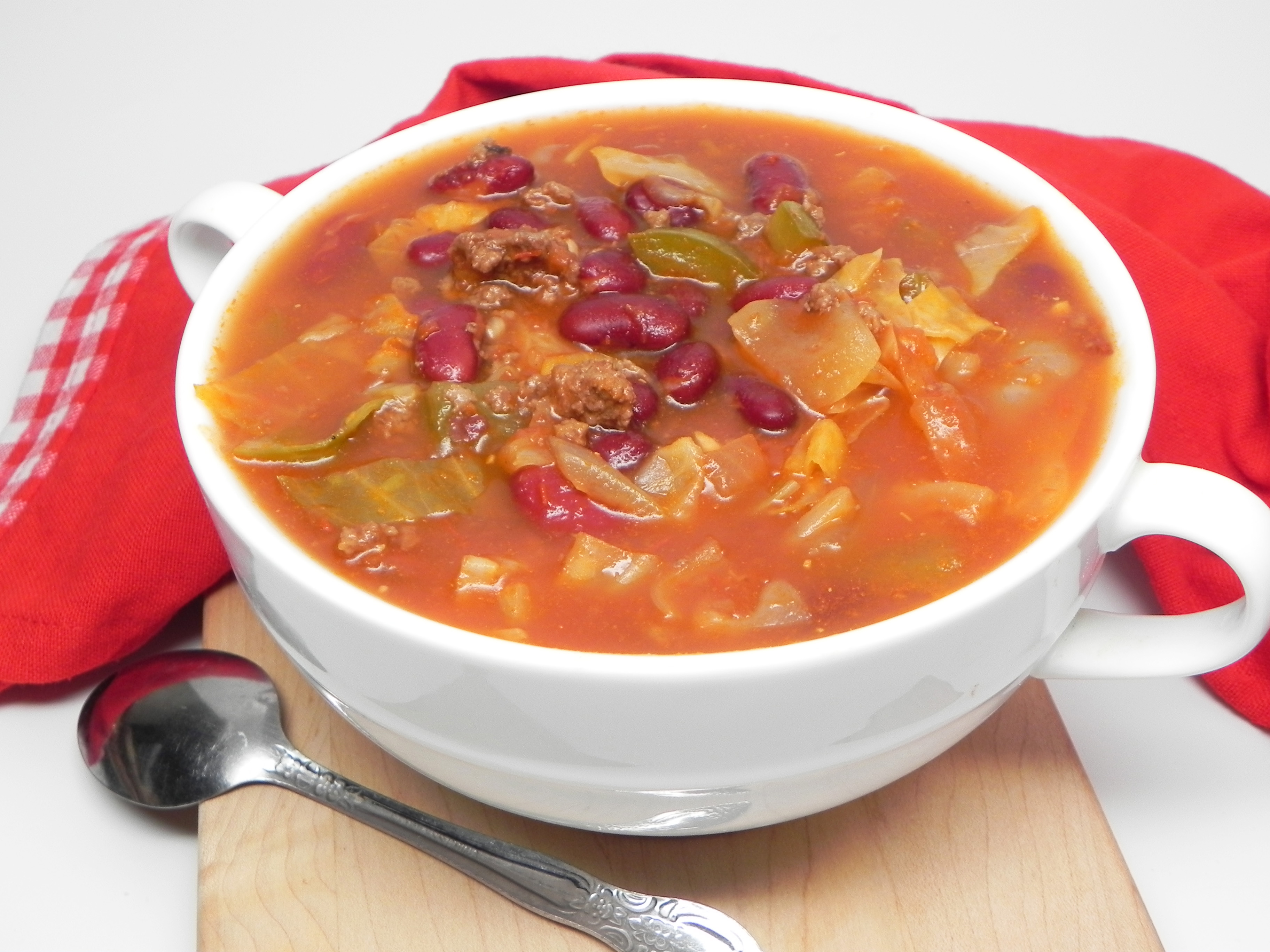 """Break out the big soup pot for this simple soup featuring ground beef, cabbage, kidney beans, and crushed tomatoes. """"I grew up in Kansas City, where my parent's would go to Shoney's once a week,"""" says Soup Loving Nicole. """"They had an all-you-can-eat soup and salad bar and it was the highlight of my week. Even as a kid, I've always loved soup. Then we moved out of state. Even though it has been nearly 40 years since I last had it, I never forgot about their beef and cabbage soup. I decided to recreate it based off my memory and here is what I came up with. Enjoy!"""""""