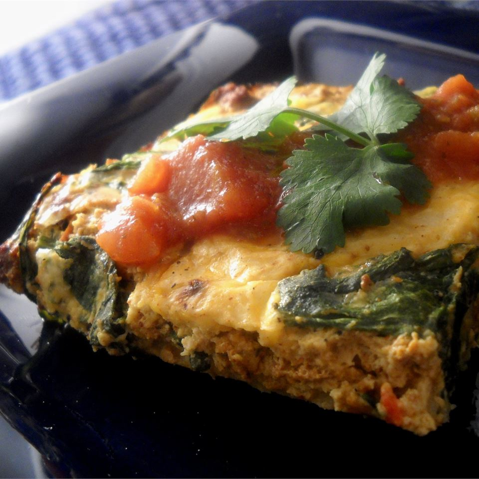 "Start your day out right with a yummy tortilla option that goes beyond the traditional breakfast burrito. Our Corn Tortilla Quiche blends eggs, corn, spices, and a tortilla crust. ""Perfect for breakfast, lunch, or dinner, the crispy tortilla crust makes this tasty quiche a snap to prepare,"" says Corinne Villa."