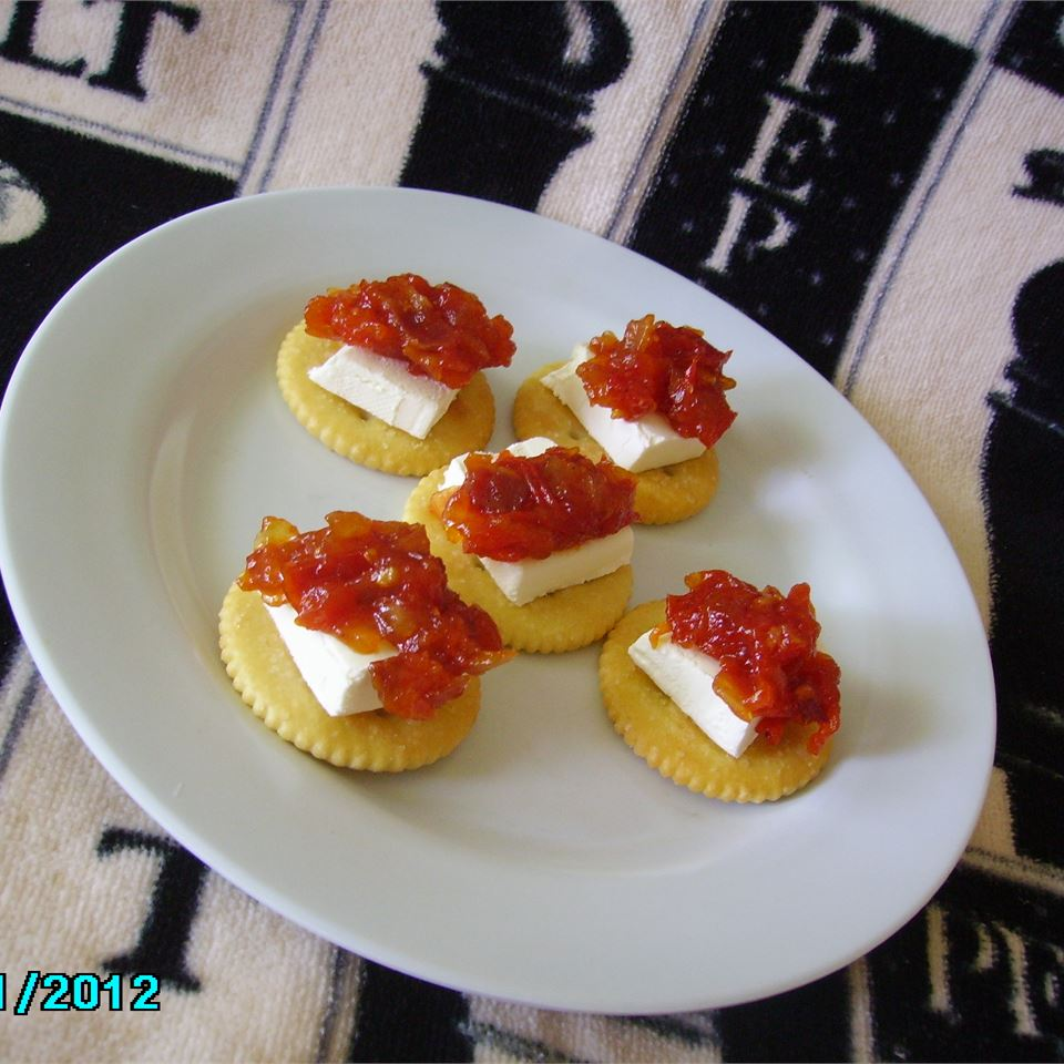 Naturally sweet tomatoes and smoky bacon work together to create this savory jam. Serve over a block of cream cheese with a side of crackers to delight guests. Better yet, jar some up for each guest, and offer it to them as a thank you gift at the end of the evening.                                   See More: Southern Appetizer Recipes
