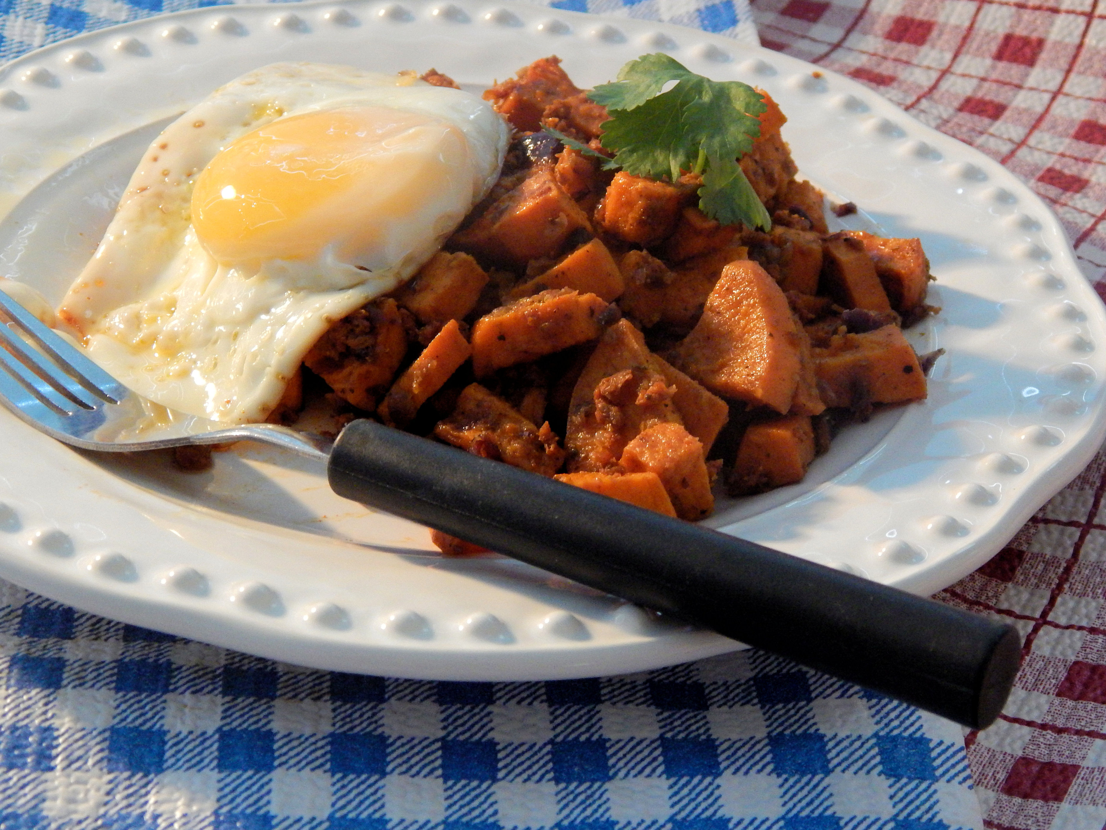 """Cubes of tender sweet potato are seasoned with herbs and spices and combined with crispy pieces of chorizo in this delicious breakfast dish that pairs well with any kind of eggs. """"This had a nice heat to it,"""" says Allrecipes Allstar Carrie C. """"The sweet potatoes really balance it out."""""""