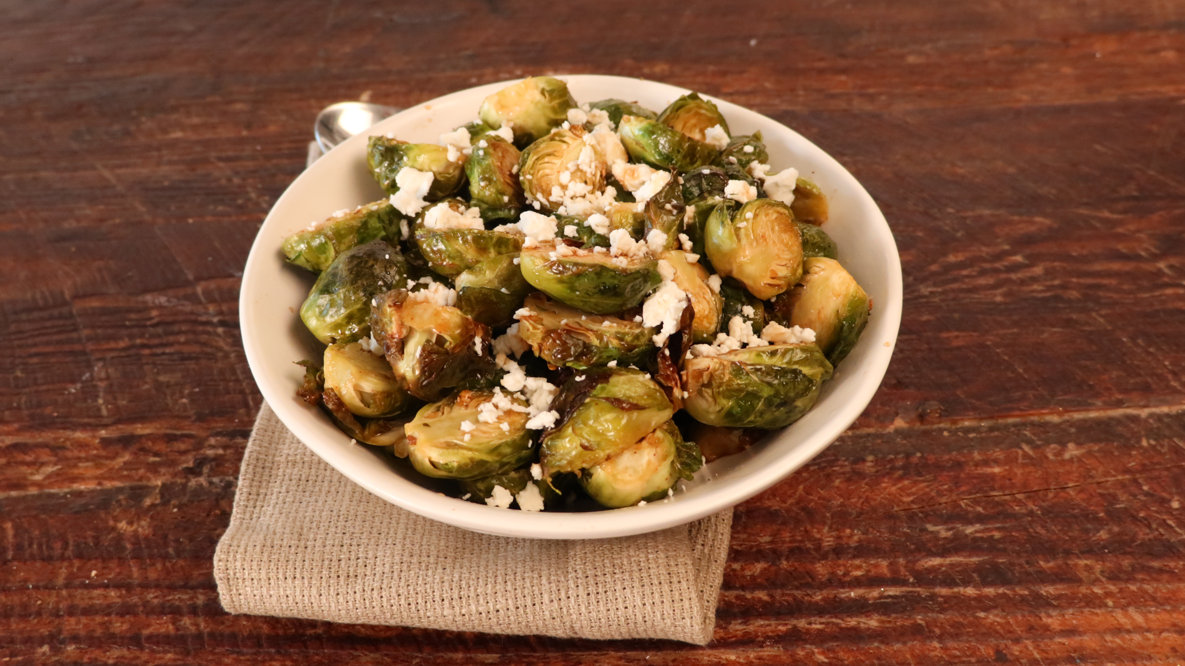 Air-Fried Brussels Sprouts With Balsamic-Honey Glaze and Feta AllrecipesPhoto