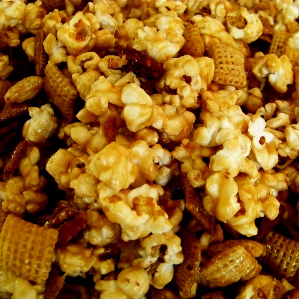 Salty and crunchy popcorn, cereal, and pretzels are coated with a buttery sugar sauce that makes this snack irresistible. Guests are sure to come back for seconds.