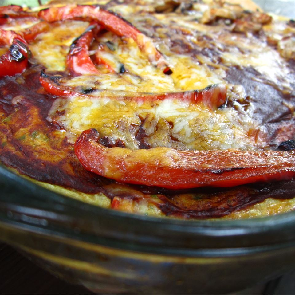 "Baked eggs, corn tortillas, and vegetables are smothered in a hearty enchilada sauce, creating azesty Mexican-inspired casserole that's easy to prepare. ""This was amazing,"" raves CECIGEE. ""Simple and easy!"""