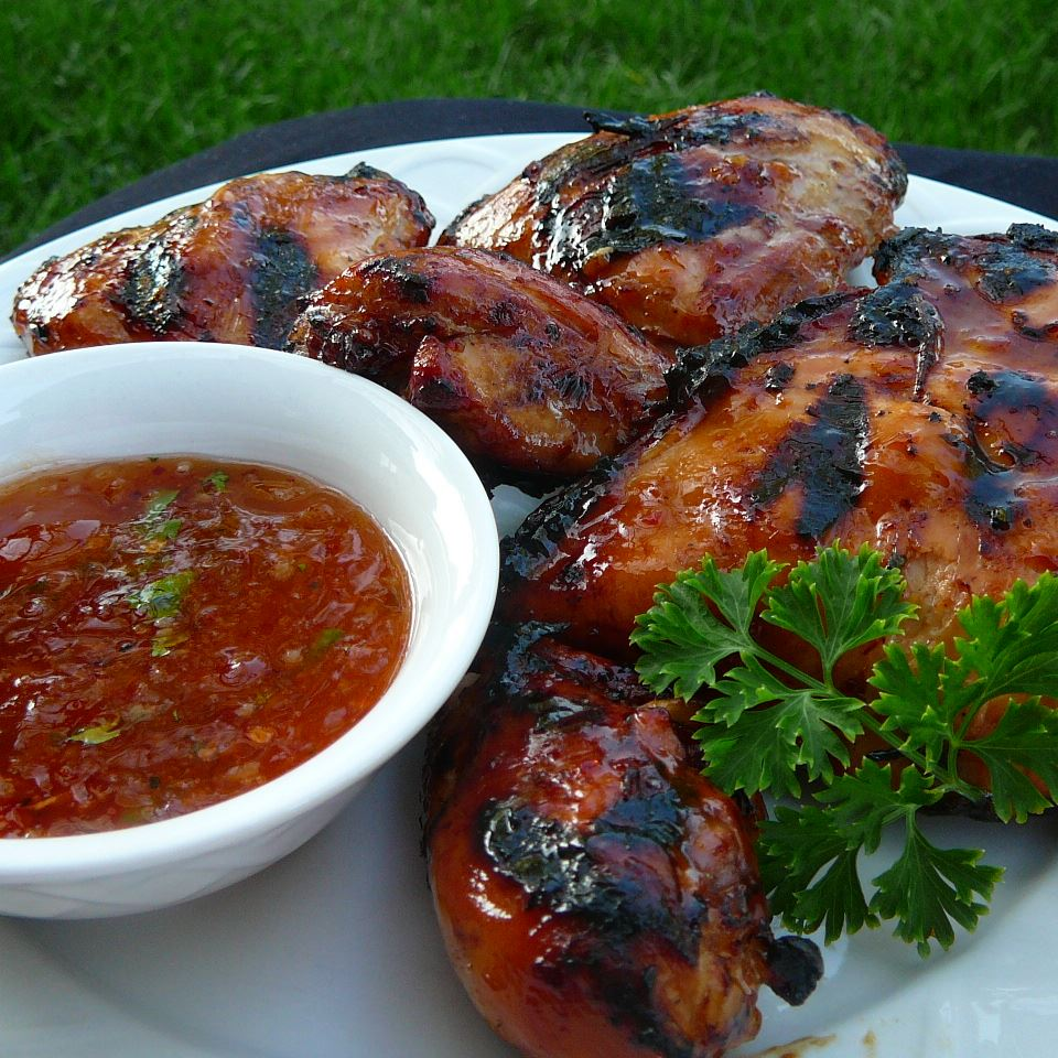 Grilled Chicken Wings with Sweet Red Chili and Peach Glaze Molly