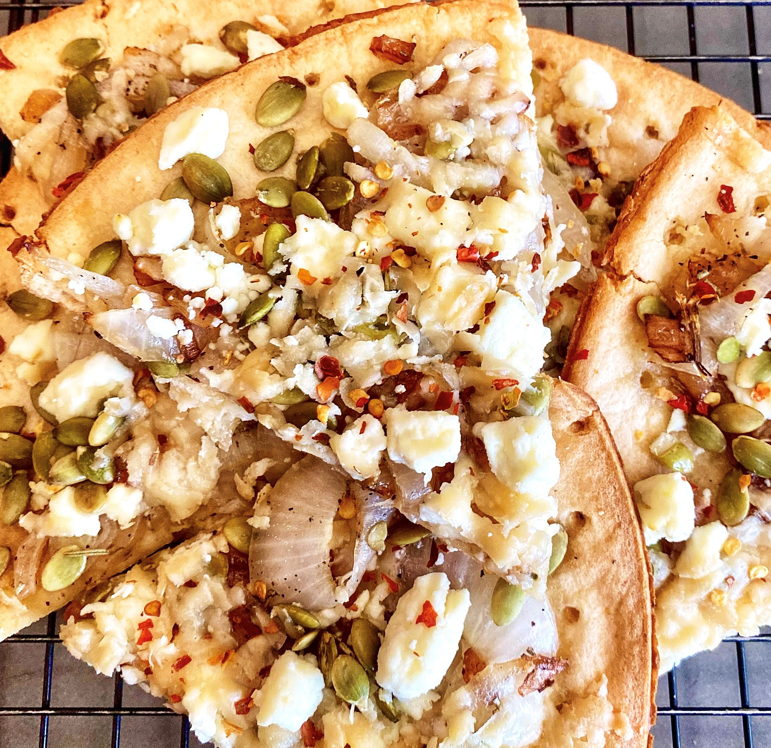 Pumpkin Seed Flatbread with Sweet Onions and Feta Yoly