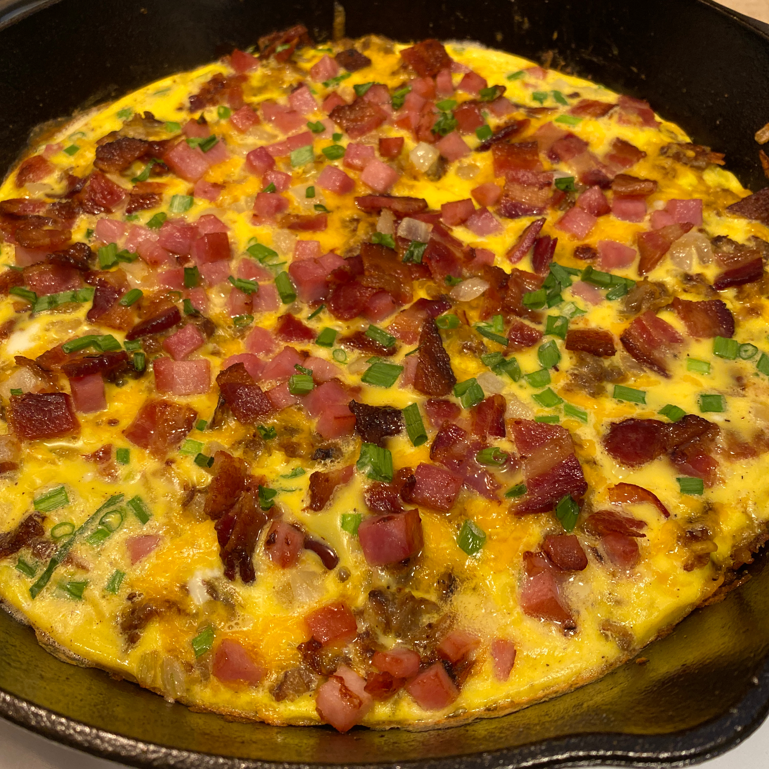 Cheesy Bacon-Sausage-Egg-Hash Brown Skillet