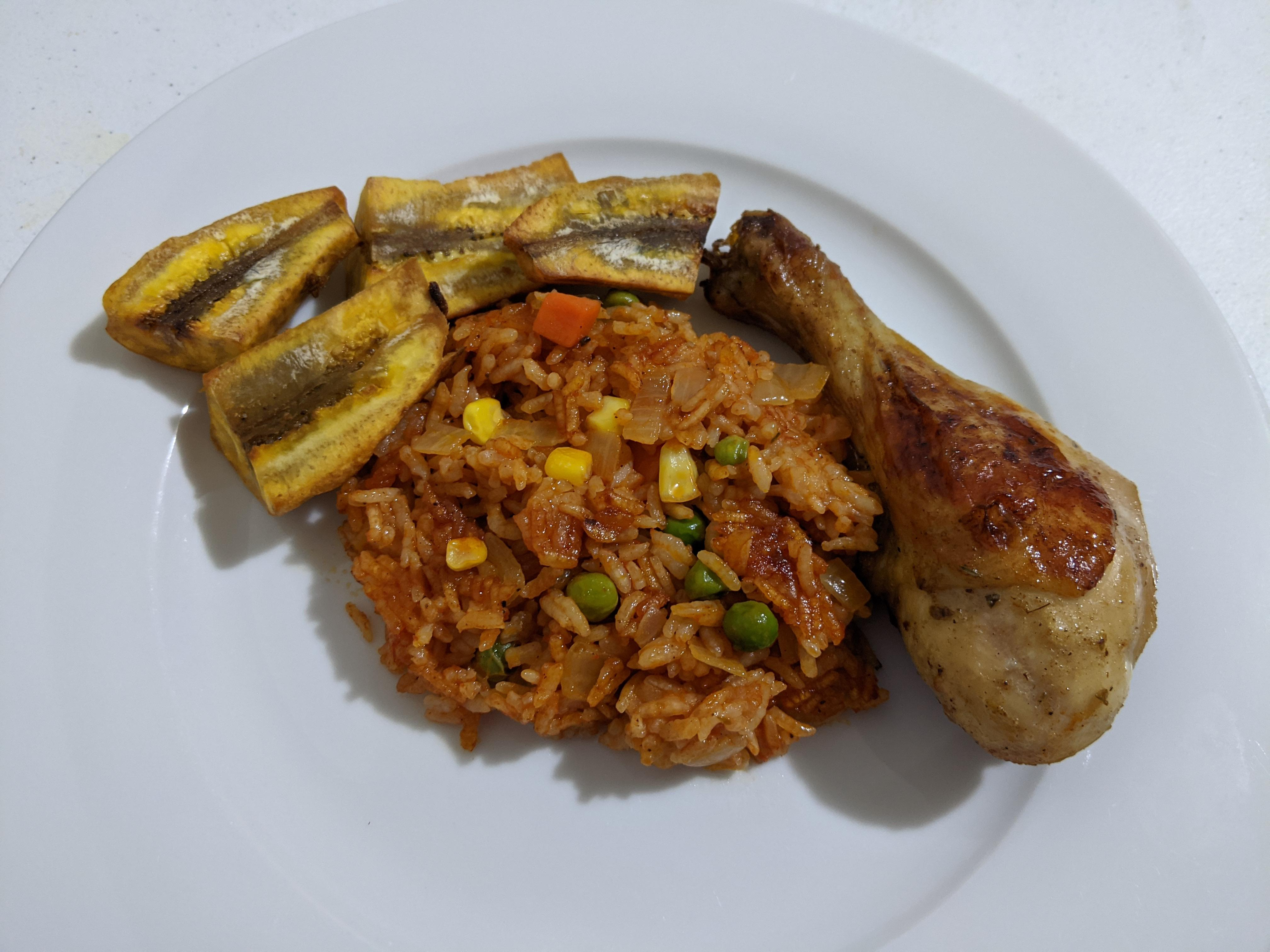 Nigerian Jollof Rice with Chicken and Fried Plantains