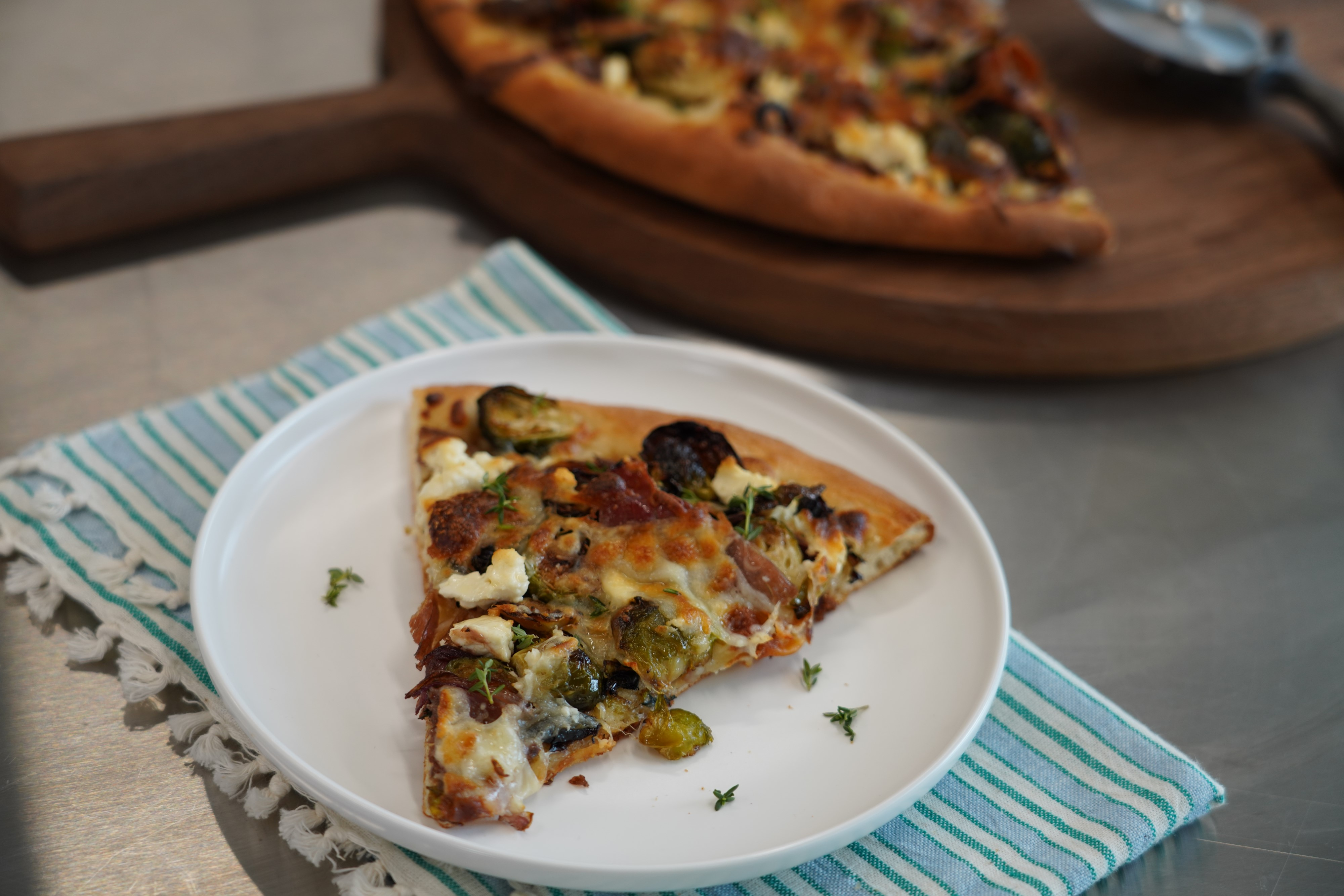 Roasted Brussels Sprouts Pizza with Prosciutto and Brown Sugar-Balsamic Onions