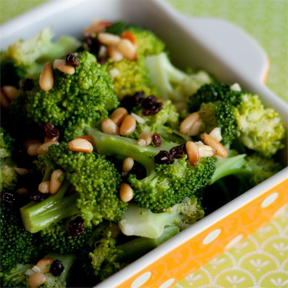 """Lightly steamed broccoli combines with toasted pine nuts, golden raisins, and a quick, tangy dressing of rice wine vinegar and minced garlic. """"This broccoli salad is perfect to bring to a summer cookout or to have as a side dish with your favorite meal."""""""