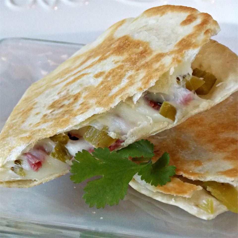 Tired of corned beef sandwiches? These corned beef quesadillas are a fantastic way to use up your leftovers. The heat of canned green chilies is a great match for the beef, as is mild, melty Monterey Jack cheese. Many reviewers brought Reuben flavors to the 'dilla with shredded Swiss and sauerkraut. Yum!