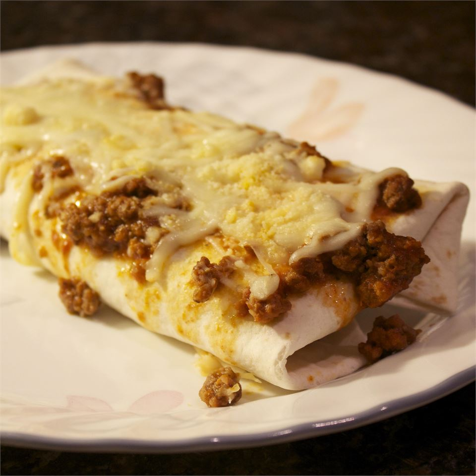 """Saucy, beefy, cheesy lasagna rolls are rolled up in flour tortillas for the ultimate quick fusion dinner. """"When you take 2 great recipes -- lasagna and burritos -- and make them something new, you get a meal that's unique!"""" says ElyseJO."""