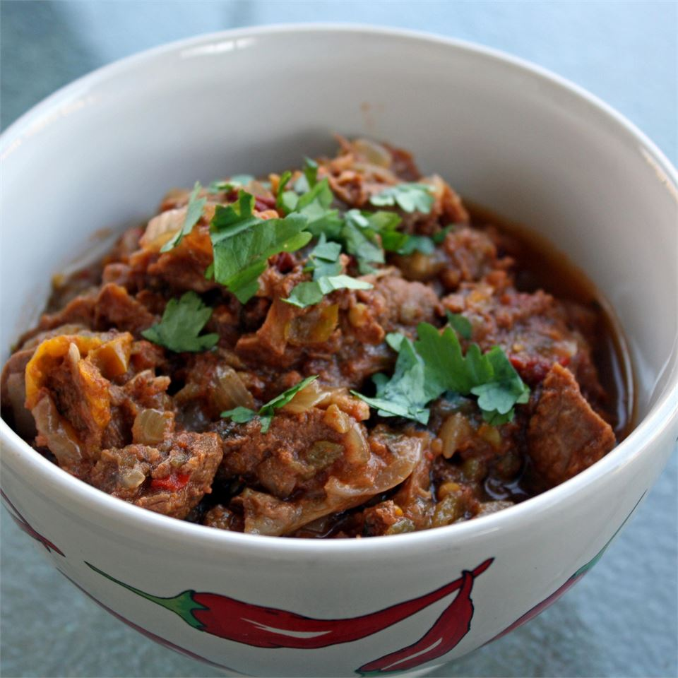 """Blazing hot peppers highlight this dish,"" says DarthsAuntie. ""Pork tenderloin is slow cooked with hot picante sauce and canned chipotle chili peppers. Start it in the morning for fiery pork burritos for dinner. I like to serve this with flour tortillas, black beans, shredded cheese, corn, and sour cream. If you are not a pork fan, substitute chicken breasts! """