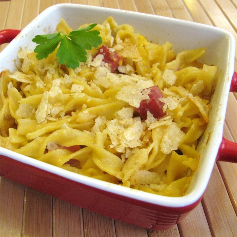 "Egg noodles and ham combine in this delightfully cheesy dish that will give you all the comfort of Grandma's house. ""My hubby is a picky eater, and it was a big hit!"" says Allrecipes user Silver Cat Eyes."