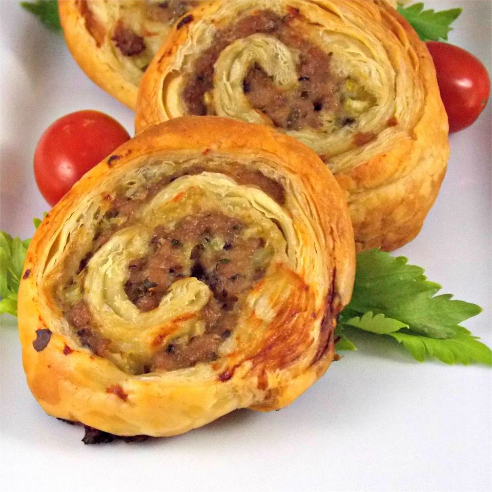 Although the recipe doesn't call for you to precook the sausage before rolling it up in the puff pastry, several reviewers recommend that do you so in order to cut down on the grease. Home cook Lynda S, however, used ground turkey flavored with Italian seasonings, and she says it wasn't greasy at all.