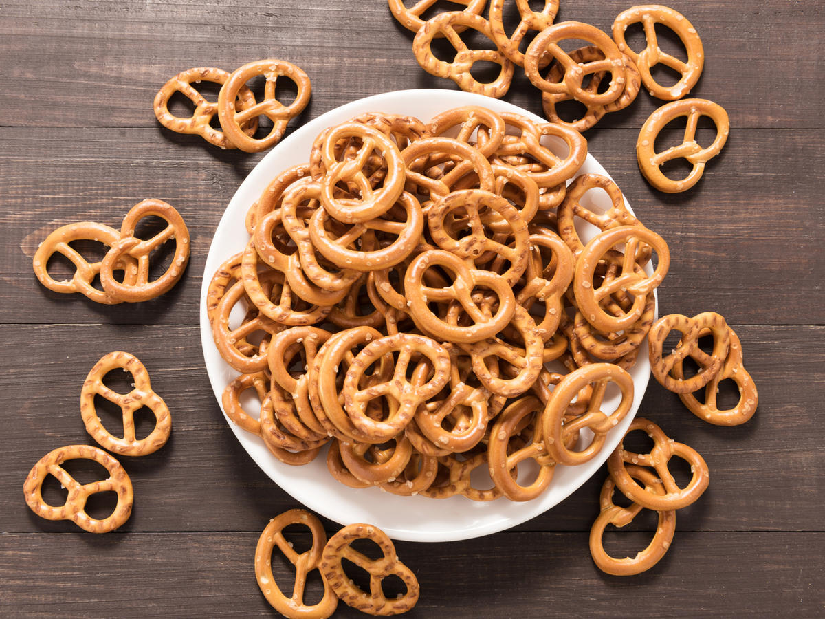 Pretzel in white dish on the wooden background.