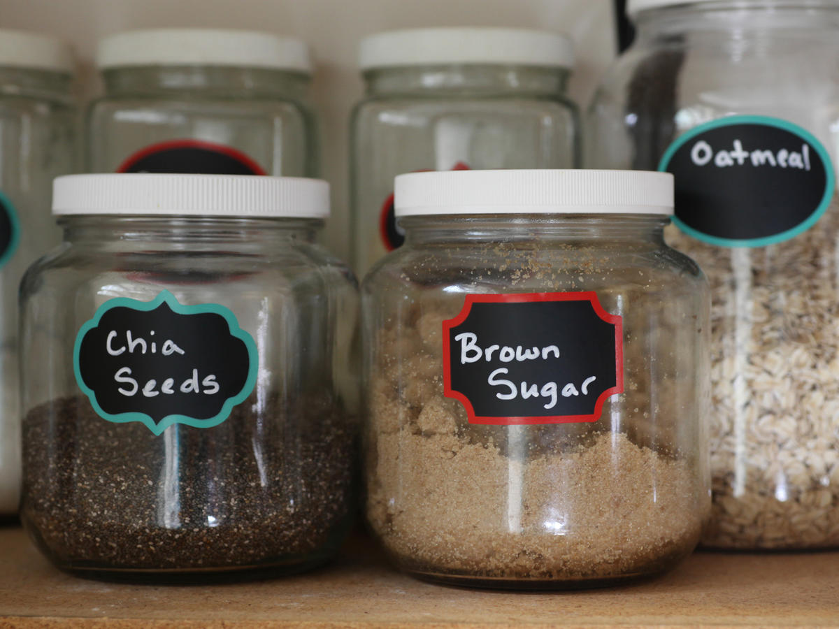 Glass Jars in Pantry with Labels