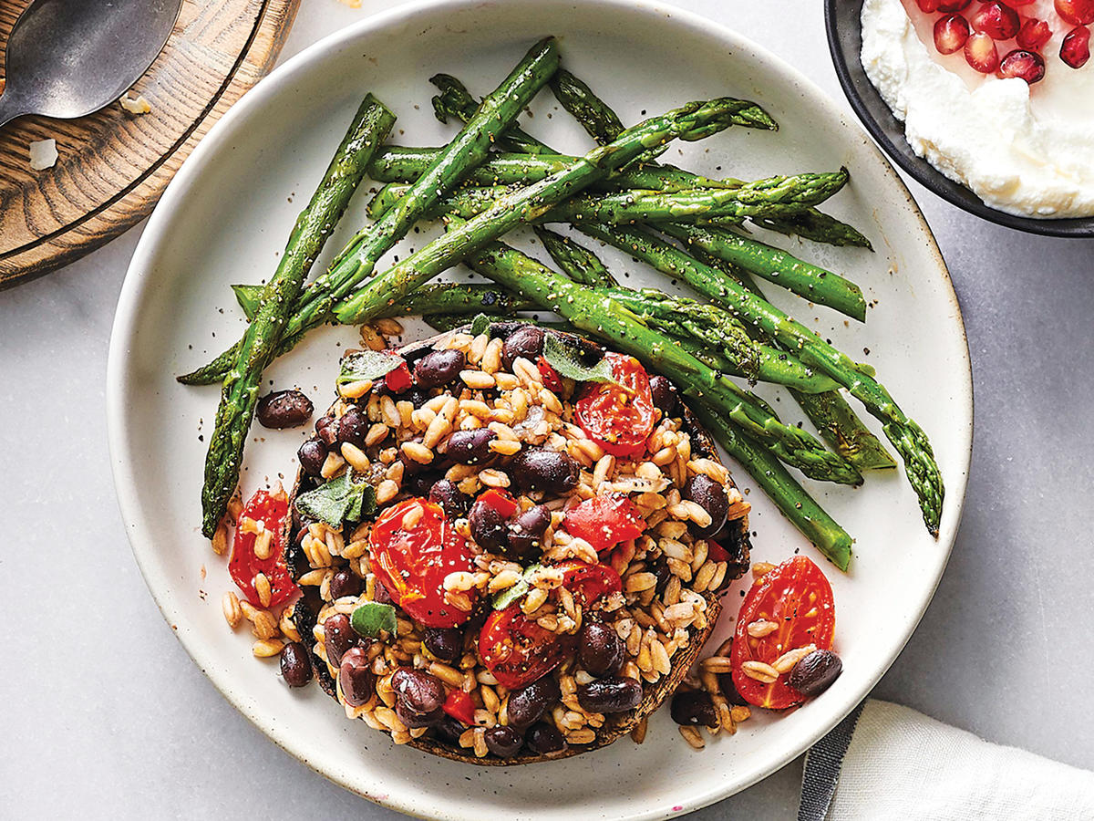 Tomato and Black Bean–Stuffed Portobello Mushroom Cap with Asparagus