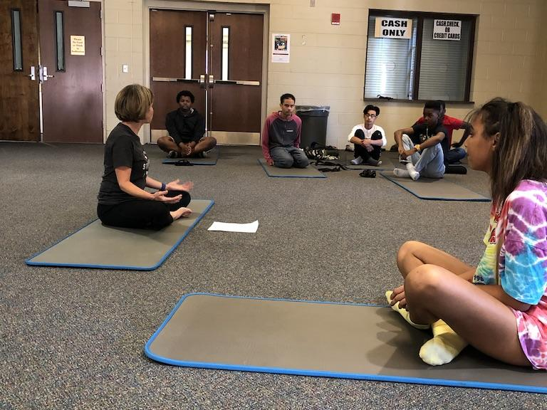 Julie Williams teaching yoga to students